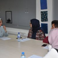 Participation in a regular workshop on conversational American dialect